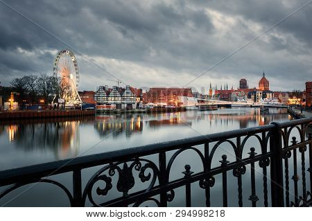 Old Town Of Gdansk, Poland At Night. Riverside And City Reflections In The Motlava River.
