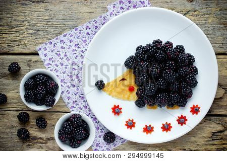 Fun And Healthy Breakfast For Kids - Edible Hedgehog From Pancake With Peanut Butter And Fresh Black