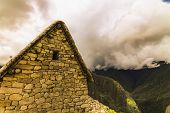 Side exterior of an Inca building with trapezoidal window in Machu Picchu poster
