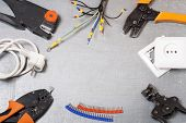 Set of electrical tools on metallic background. Energy concept.Copy space for text. poster