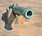 Old artillery gun. The gun for the cores, covered with patina. Located at the royal palace in Morocco poster