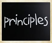 """Principles"" handwritten with white chalk on a blackboard poster"