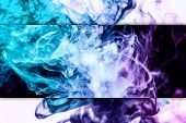Frozen abstract movement of  explosion pink and blue  smoke multiple colors on black and white background. Background from the smoke of vape poster
