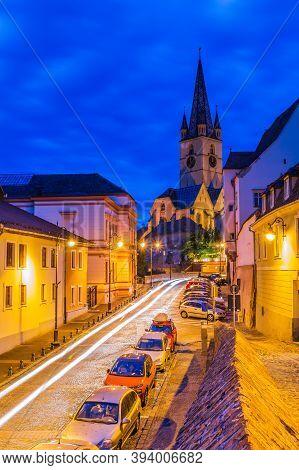 Sibiu, Romania. Cathedral At Twilight In Transylvania, Eastern Europe.