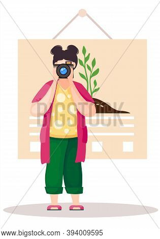 Girl Standing And Adjusting The Lens. Photographer With Poster With A Planted Tree On Background. Gr