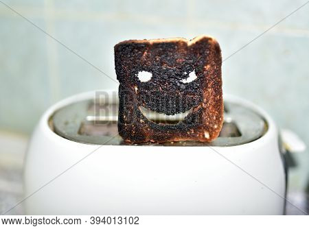 Burnt Toast With An Angry Face Expressing The Emotion Of Sadness Or Sarcasm. Burnt Toast Bread Slice