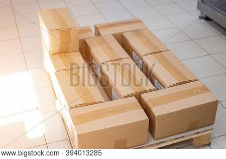 Pallet With Cardboard Boxes In Production. The Concept Of Cheap And Durable Cardboard Packaging At A