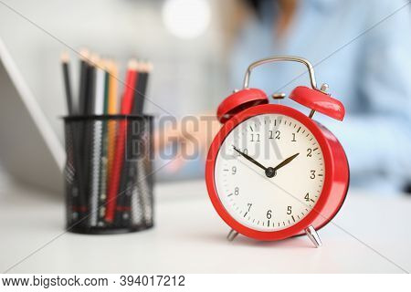On Desktop Red Alarm Clock And Colored Pencils. Time Planning Time Management Concept