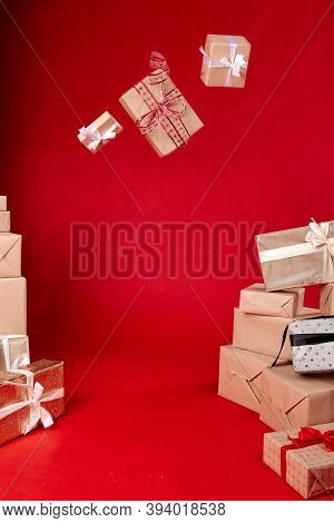 Gifts In The Air On A Red Background.