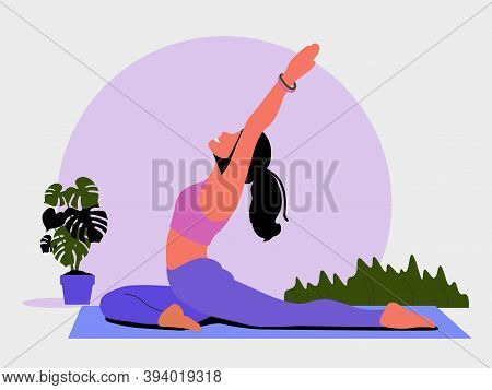 Young Woman Sits In A Yoga Pose And Meditates. The Girl Doing The Stretching Exercises At Home.  Phy