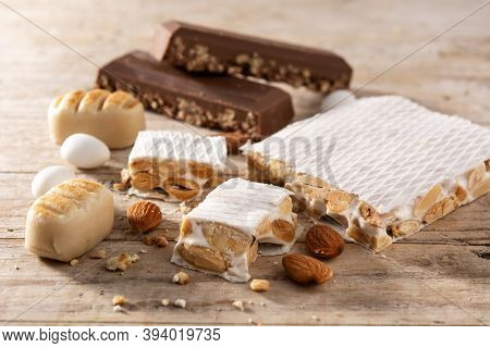 Assortment Of Christmas Nougat On Wooden Background