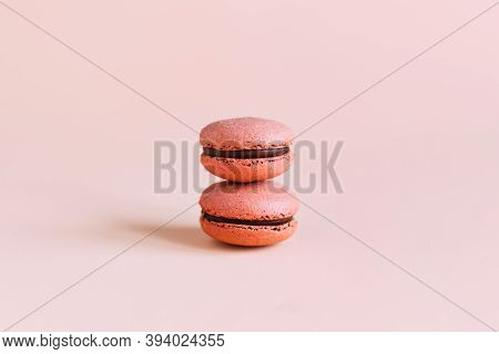 Tasty French Macaroons On A Pink Pastel Background. Place For Text.