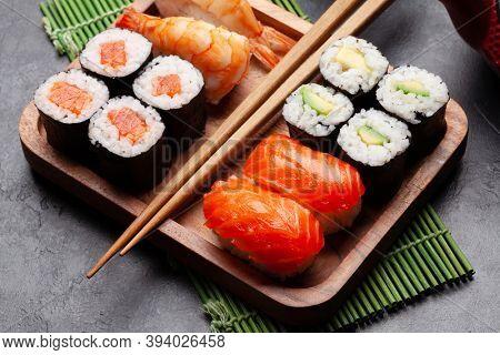Japanese sushi set on wooden plate