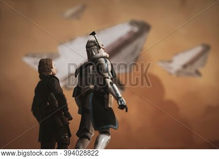 NOV 8 2020: Scene from Star Wars The Clone Wars with General Anakin Skywalker and Clone Commander Rex looking up at Republic star cruisers - Hasbro action figures