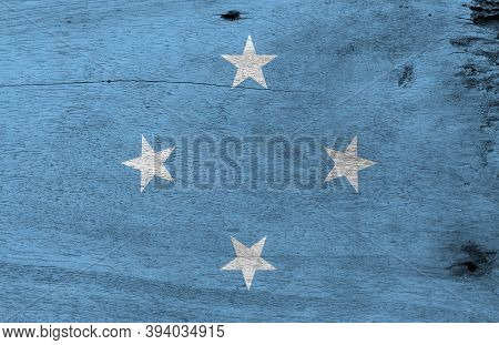 Flag Of Federated States Of Micronesia On Wooden Plate Background. Grunge Federated States Of Micron