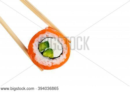 Roll Philadelphia With Salmon. Japanese Sushi With Chopsticks. Roll Philadelphia Sushi With Cream Ch