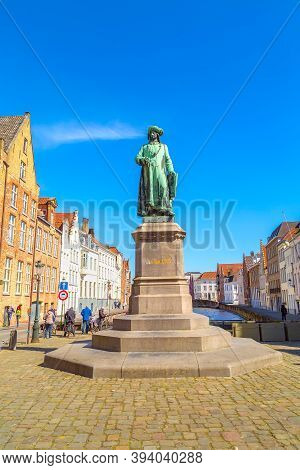 Bruges, Belgium - April 10, 2016: Statue Of Jan Van Eyck And People At The Street Of Bruges, Belguim