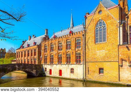 Bruges, Belgium Scenic Cityscape With Medieval Houses, Bridge And Canal In Brugge