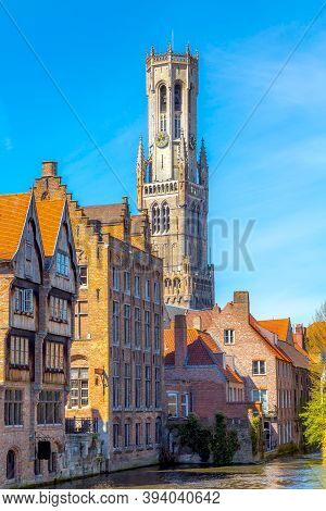 Bruges, Belgium Iconic Cityscape With Medieval Houses, Tower Belfort And Rozenhoedkaai Canal