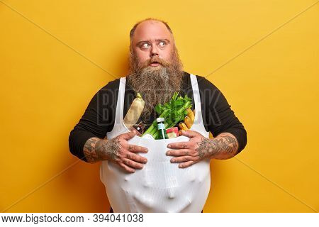 Obese Greedy Man Stocks Foodstuff, Eats Too Much, Suffers From Overweight And Gluttony, Keeps Hands