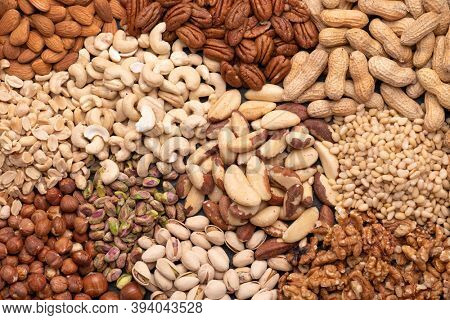 Assortment of various nuts such as cashew nuts, brazil nuts, peanuts, almonds, pecan and other, top view