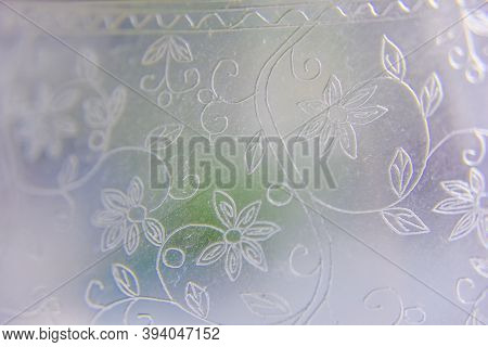 The Ornament On The Glass With Purple, Green And Blue Blurs On The Back, Selective Focus