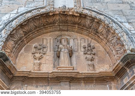 Campos, Balearic Islands/spain; November 2020: Stone Arch With Religious Sculpture Outside The Churc