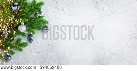 Christmas or New Year background with green fir branches and Christmas ornaments.  Winter holiday concept, top view, copy space