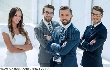 group of successful business people on the background of the office