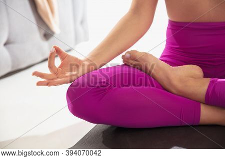 Padmasana. Close Up Of Beautiful Young Woman Working Out Indoors, Doing Yoga Exercise On Gray Mat, D