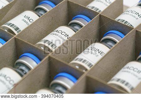 Coronavirus COVID-19 vaccine. SARS-Cov-2 Ncov-2019 vaccine ampoules  in a box.