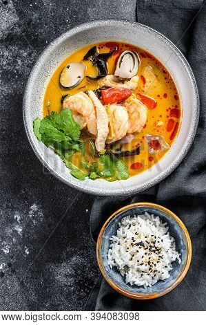 Tom Yam Kung Soup, Thai Cuisine. Black Background. Top View