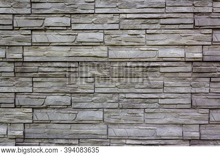 Gray Background Of Imitation Stone Masonry Tiles For Exterior Walls Of Buildings And Structures. Dec