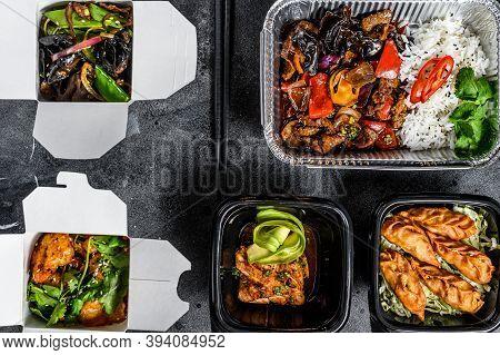 Choosing Take Away Food. Spring Rolls, Dumplings, Gyoza And Wok Noodles In Box. Take And Go Organic