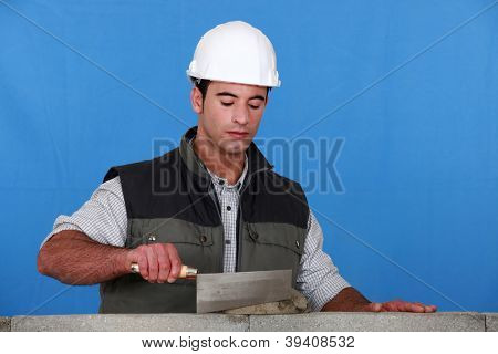 bricklayer using trowel