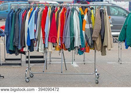 Winter Clothing Garment Hanging On Rails At Flea Market