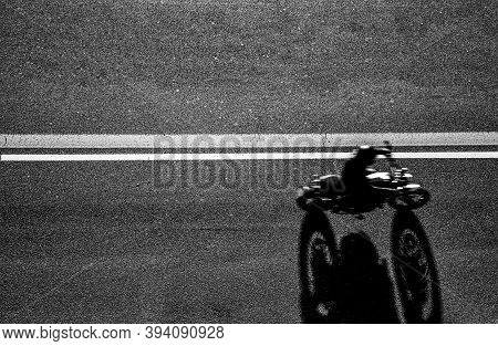Top View Of The Biker Driving His Motorcycle On The Asphalt Road - Man Is Traveling With His Bike, V