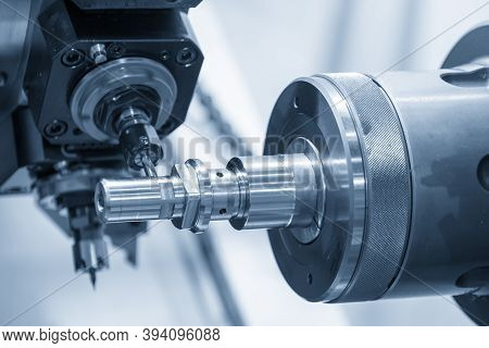 The Operation Of Turn-mill Machine Slot Cutting On The Metal Shaft Parts. The Hi-technology Automoti