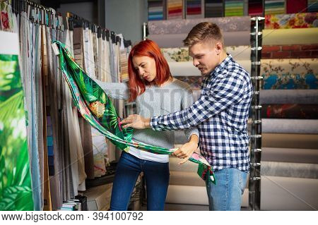 Cloth Touching. Couple Choosing Textile At Home Decoration Store, Shop. Making Of Home Interior Desi