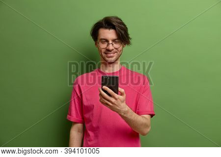 Happy Hipster Guy Uses Mobile Phone Application, Reads Positive News From Social Networks, Being Con