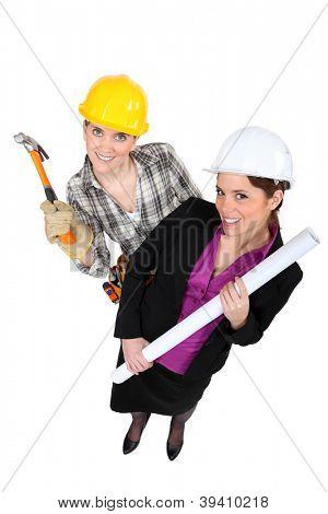 High-angle shot of a tradeswoman standing next to an engineer