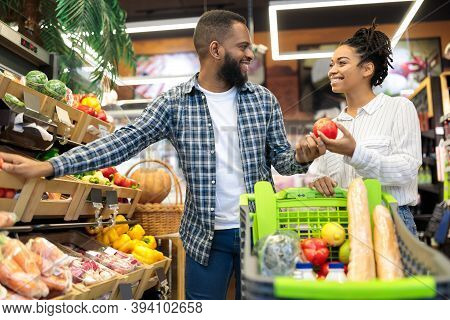 Happy Black Family Couple In Supermarket Grocery Shop Buying Fresh Organic Vegetables Shopping Food