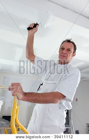 Tradesman painting a ceiling t-shirt