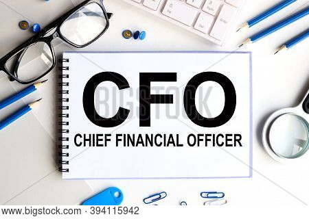 Cfo, Chief Financial Officer, Text On White Paper On Light Background