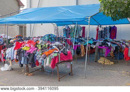 Second Hand Garment  Clothing Under Tent At Flea Market