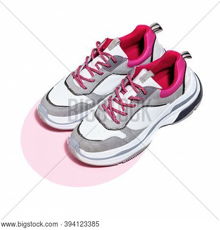 High Angle View Of A Sport Shoes On The Pink Circle Confetti Background. Reducing Weight, Getting Fi