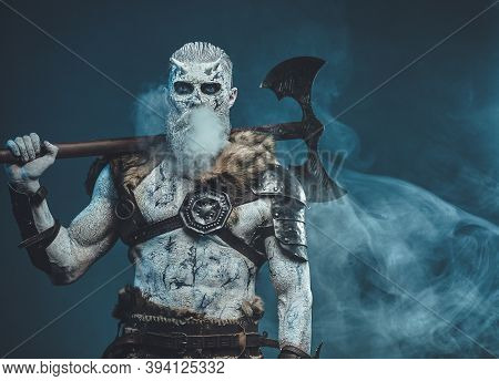 Nordic Undead In Dark Armour With Fur And Naked Torso With Cold Breath And Huge Axe On His Shoulder