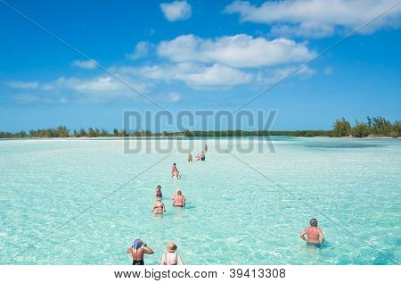 Tourists Go Wading To Explore The Island Of Cayo Largo. Cuba