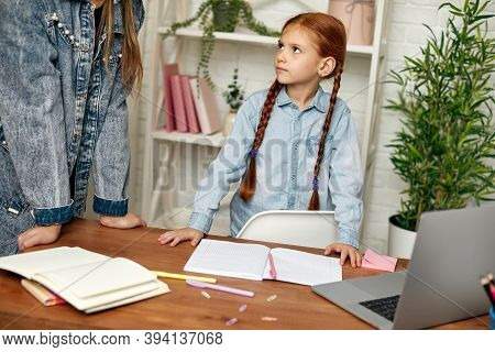 Little Child Girl Child Does Not Want To Study Online. Mom Makes Daughter Learn Lessons. Hard Online