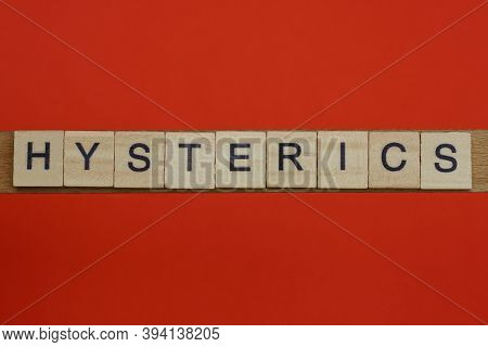 Word Hysterics From Small Gray Wooden Letters Lies On A Red Background